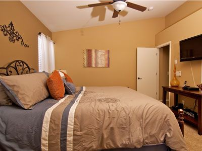 Master Bedroom has a King-size bed, Flat Screen TV, Ceiling Fan & Private Bath