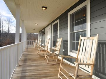 Enjoy mountain views from a rocking chair on the three-sided wrap around porch.
