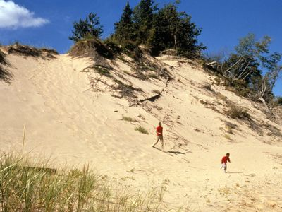 Running up and down nearby dunes is a fun activity for families.