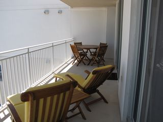 Fort Walton Beach condo photo - Teak furniture on balcony (2 steamer chairs, coffee table, table & 4 chairs).