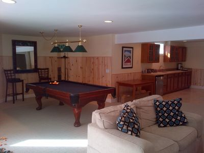 BIG lower level includes billiards, wetbar & 50' tv - perfect for kids & adults