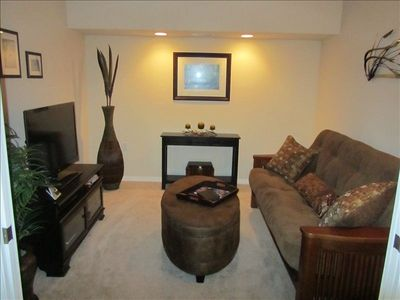 "Den has 42"" LED TV with DVD player. Couch can make into comfortable full bed."