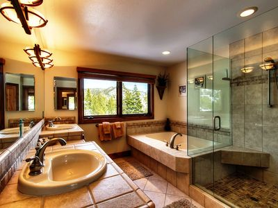 MBR bath with spa tub & dual shower heads for two & large walk-in closet.