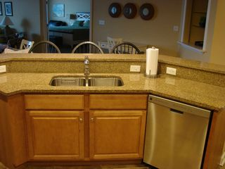 Oceans Mist Ocean City condo photo - Back of Food Bar, Sink and New Kenmore Elite Dishwasher