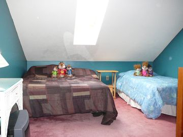Gopher a family vacation and stay in this open loft with Queen and twin bed.
