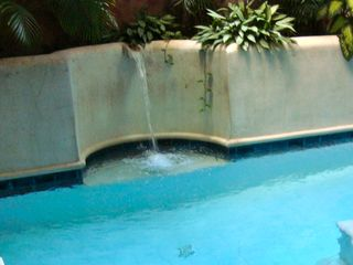 Centro apartment photo - Relaxing swimming pool fountain