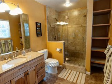 Master bath with dual shower heads and heated floor.