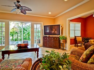Key West house photo - The living room has French doors to the back yard.