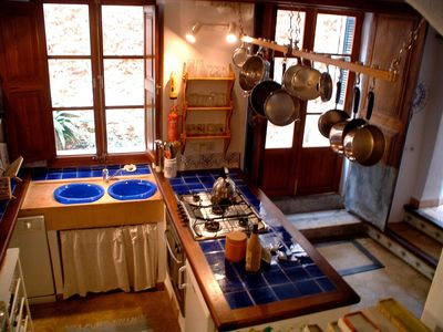 Fornalutx cottage rental - Esqueredo: Kitchen leading onto sunny patio