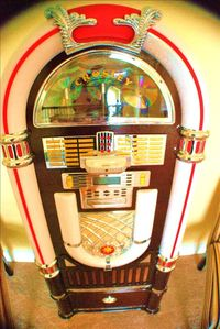 Retro Juke Box! Area also has wall mounted TV and pool table