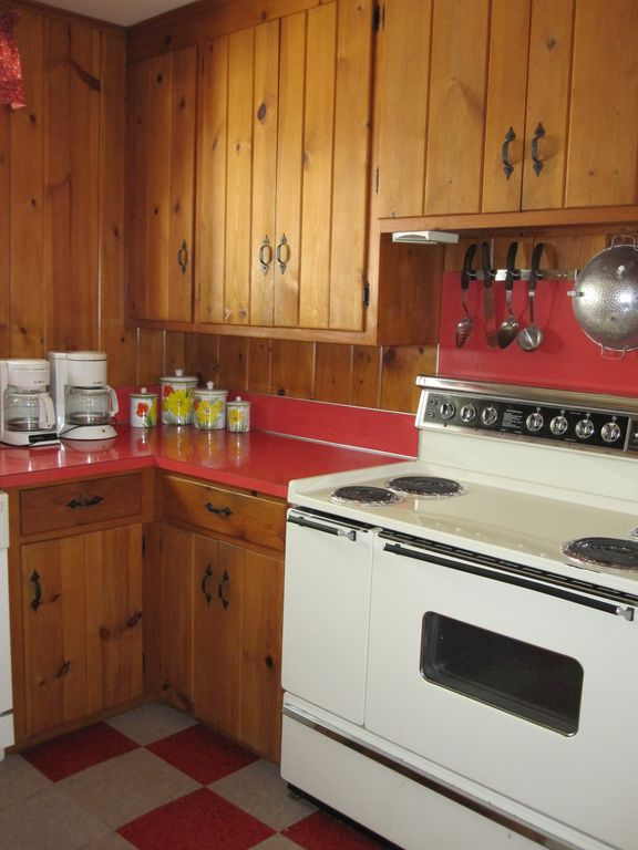 Kitchen boasts two refrigerators, 1.5 ovens, microwave, and dishwaser.