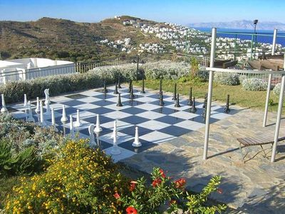 Giant ground chess, tennis courts, kids play area