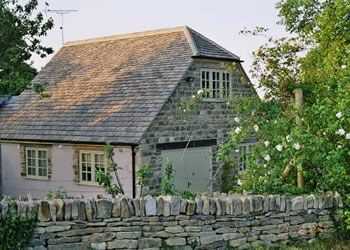 Exterior of Well Close Cottage in June