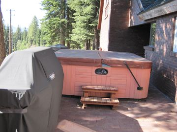 8 person hot tub and large weber gas grill with rotisserie and smoker box.