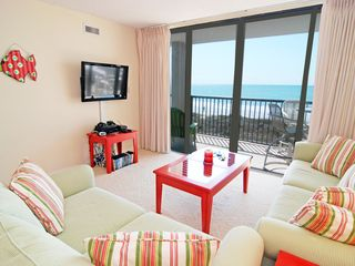 Family room with mounted TV and gaming system - Windy Hill condo vacation rental photo