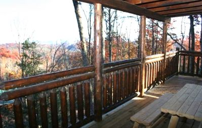 Enjoy a meal and the scenery from the log picnic table on the covered deck