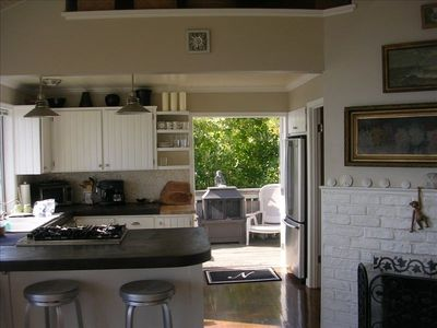 Upper Level Unit: French doors opens to private deck - gas grill & dining table.