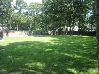 Hampton Bays house photo - HUGE Backyard with lots of room for the kids to play.