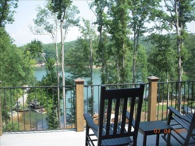 Rocking chairs on main level to take-in blue ridge mountains, lake and sunsets