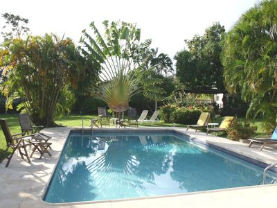 Large swimming pool in an acre of lovely gardens
