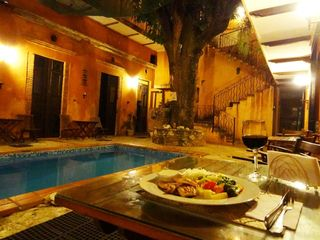 Santo Domingo hotel photo - Nice dining in open patio by the pool under the 200 year old mango tree