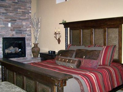 Luxurious master suite with stone fireplace, distributed audio and huge balcony
