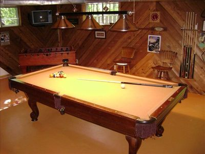 The game room....a professional size pool table, foosball, and electronic darts.