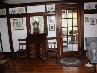 Chatham house photo - The living room opens onto the porch. A small sitting area is to the right.