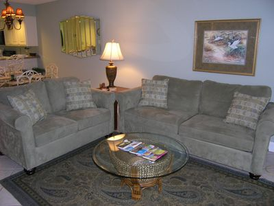 Living room with love seat and queen sleeper sofa.