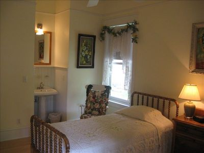 Yellow Bedroom: two twin beds, pedestal sink, ceiling fan, closet, dresser