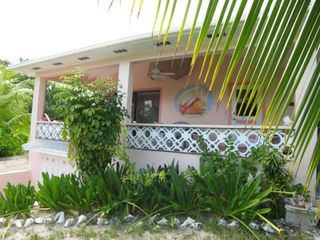 Covered verandah offers wonderful sea views and shade. - Spanish Wells villa vacation rental photo