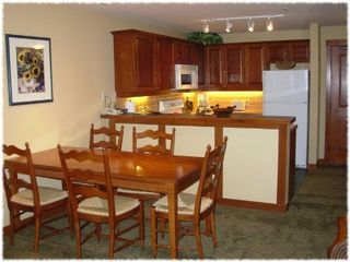 Solitude condo photo - Kitchen, eating area, and bar. Wireless networking provided.
