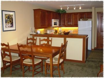 Kitchen, eating area, and bar. Wireless networking provided.