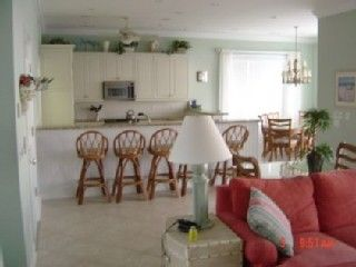 Garden City Beach house photo - Downstairs oceanfront kitchen and large double dining room