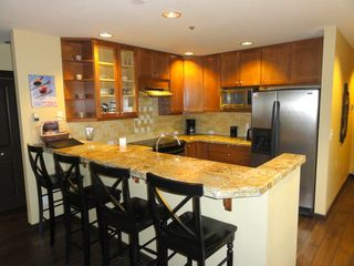 Steamboat Springs condo photo - Kitchen with all the upgrades - granite, wood floors, stainless steel appliances