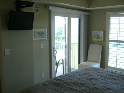 Bedroom opens to balcony and has a HDTV.
