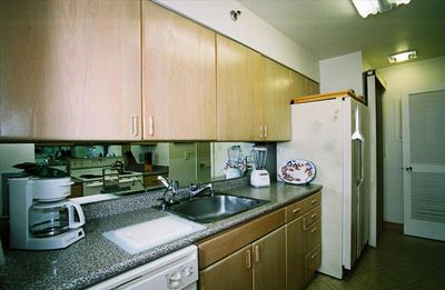 Fully applianced kitchen includes small pantry and washer & dryer