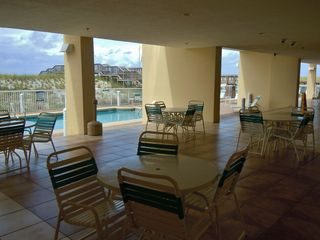 Navarre Beach condo photo - Poolside Lanai offers a shaded alternative