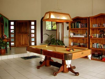 Upscale hihg quality pool table for added entertainment / expansive library !
