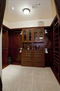 Master walk-in closet has a flat-panel TV on a swing arm for easy viewing!