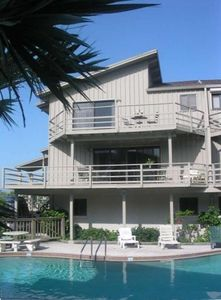 3 story private townhome with private garage, overlooks refreshing pool.