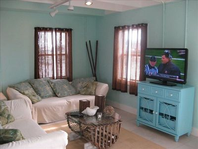 Living room with large flat screen tv.  Relaxing is easy at the Aqua Pearl!