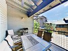 Balcony - Dine alfresco on the covered balcony, furnished with table seating for 6.
