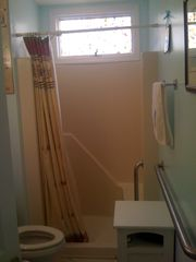 Downstairs Bathroom with Handicapped rails for extra support,benched shower - Beach Haven Crest house vacation rental photo
