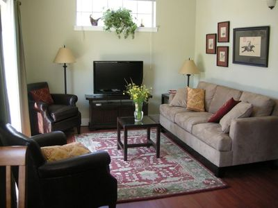 Living room with leather chairs, flat screen/ DVD, 'Pottery Barn' decor