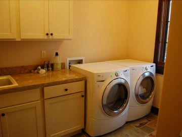 Full size laundry room with additional side sink.