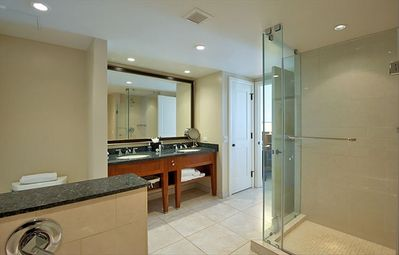 Bathroom with separate tub and glass enclosed shower.
