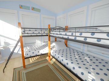 3rd floor loft/bedroom with 4 twin size beds.