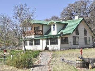 Sonoita house rental - The passive sunroom and Master balcony face east.