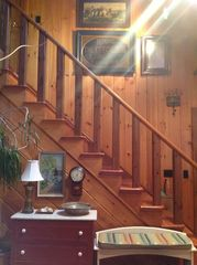 Stairs lead to TV Den/ Library & Bedroom with 3 twin beds - Kennebunk house vacation rental photo